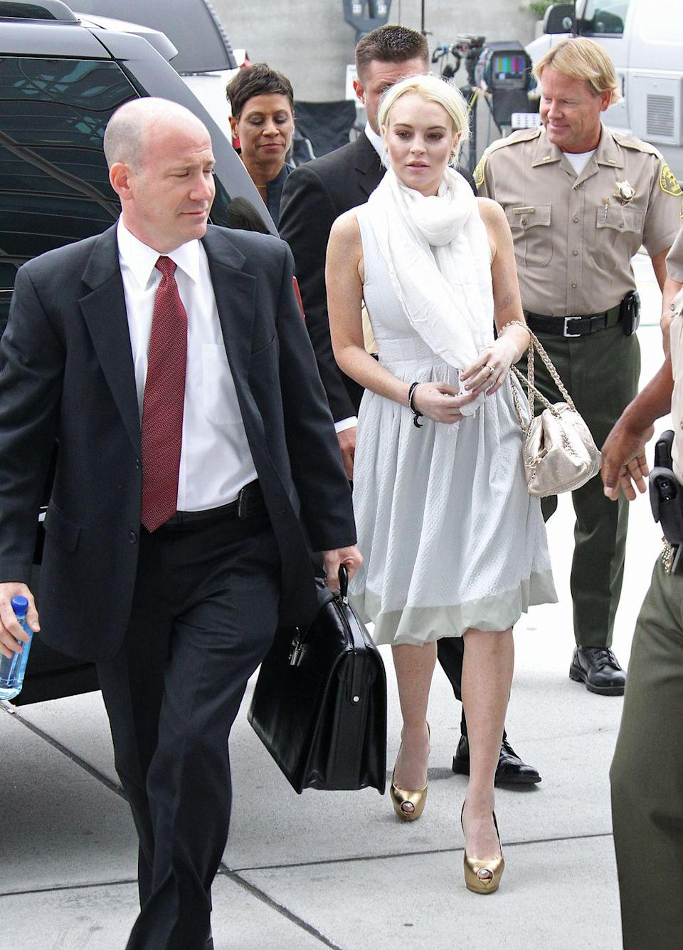 <p>An iconic shoe trend of the era—LiLo opted for a gold pair, which she wore to a court hearing.</p>