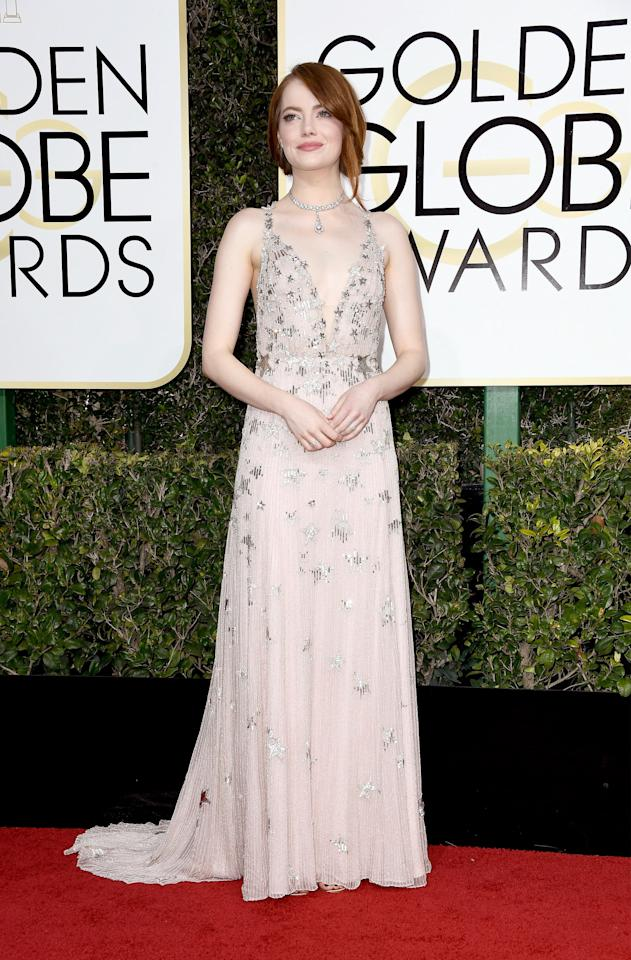 """<p><a rel=""""nofollow"""" title=""""Latest photos and news for Emma Stone"""" href=""""https://www.popsugar.com/Emma-Stone"""">Emma Stone</a> in <a rel=""""nofollow"""" href=""""https://www.popsugar.com/fashion/Emma-Stone-Valentino-Dress-Golden-Globe-Awards-2017-42961650"""">a Valentino dress</a>, Tiffany & Co. jewels, and Jimmy Choo shoes in 2017.</p>"""