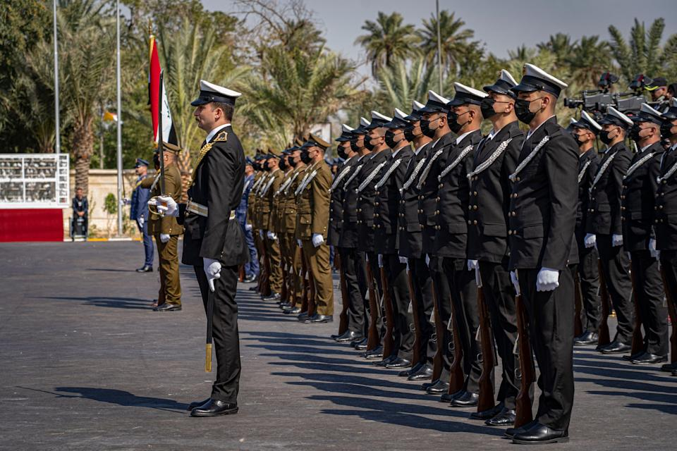 Guards at the presidential palace greet Pope Francis on his first visit to IraqBel Trew
