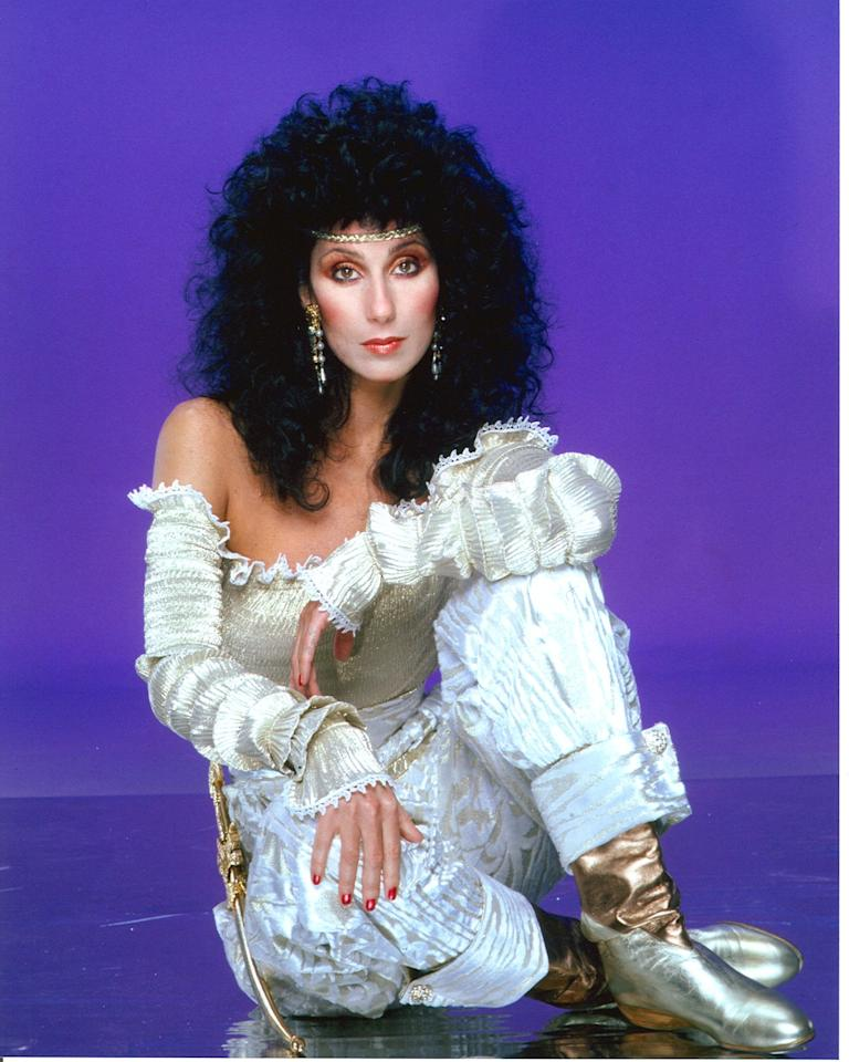 <p>Cher poses for a photo session in June 1981 in Los Angeles, California wearing her curls down and out, as well as head-to-toe metallic.</p>