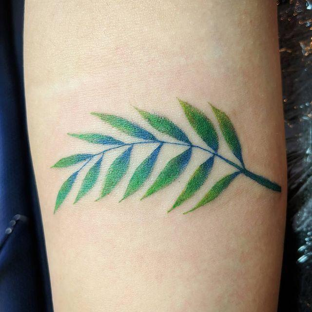 "<p>Since black outlines rarely exist in nature, why throw them in a nature-inspired tattoo? This blue and green leaf design looks cool on its own.</p><p><a href=""https://www.instagram.com/p/BiQwid9Freb/?utm_source=ig_embed&utm_campaign=loading"" rel=""nofollow noopener"" target=""_blank"" data-ylk=""slk:See the original post on Instagram"" class=""link rapid-noclick-resp"">See the original post on Instagram</a></p>"