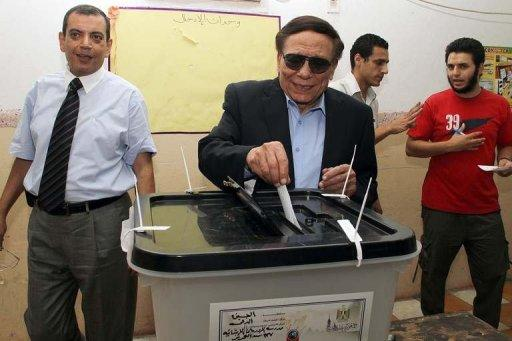 Egypt's veteran comedian Adel Imam casts his vote at a polling station in Cairo in June 2012