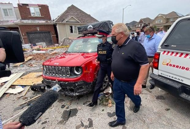 On Friday afternoon, Premier Doug Ford toured the area devastated by a tornado in Barrie, Ont., saying the province will help affected residents in whatever way it can.  (Martin Trainor/CBC - image credit)