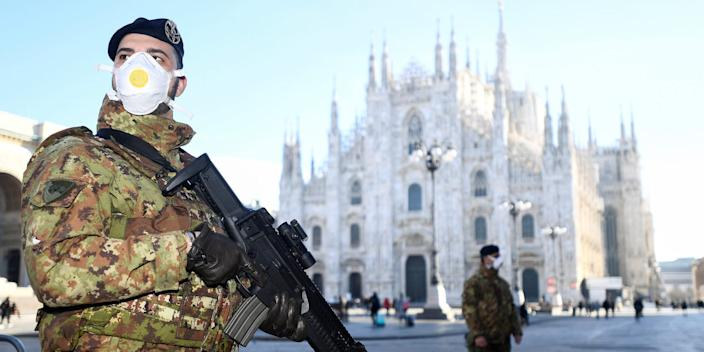 Military officers outside the Duomo cathedral, closed by authorities because of the coronavirus outbreak, in Milan on February 24.