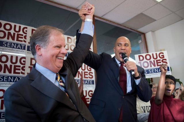 Cory Booker with then senatorial candidate Doug Jones in Birmingham, Ala., last December. (Photo: Jim Watson/AFP/Getty Images)