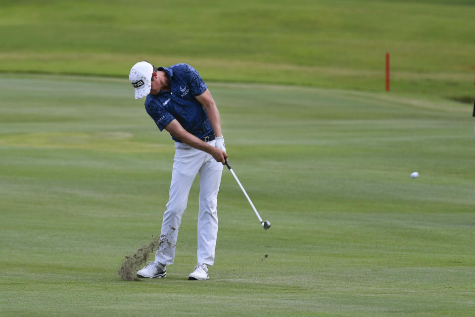 Harris English hits on the 18th fairway during the first round in the World Golf Championship-FedEx St. Jude Invitational tournament, Thursday, Aug. 5, 2021, in Memphis, Tenn. (AP Photo/John Amis)