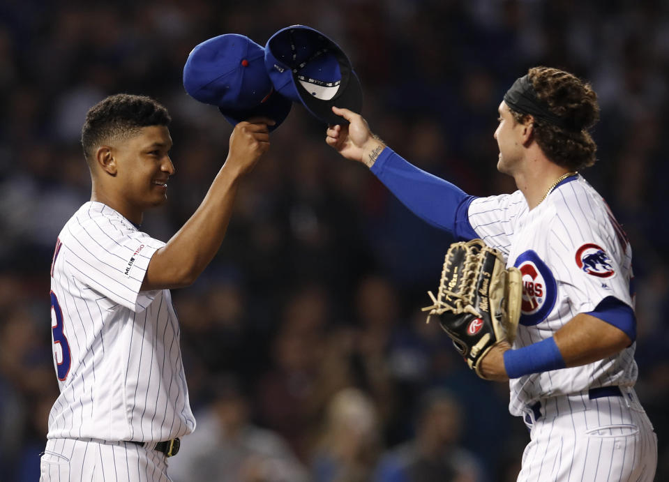 Chicago Cubs' Adbert Alzolay, left, is congratulated by Albert Almora Jr. on his first win in the majors, against the New York Mets in a baseball game Thursday, June 20, 2019, in Chicago. The Cubs won 7-4.(AP Photo/Jim Young)