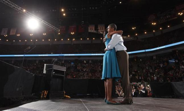 Barack Obama and first lady Michelle embrace during a campaign rally at the Ohio State University in Columbus, Ohio May 5, 2012.