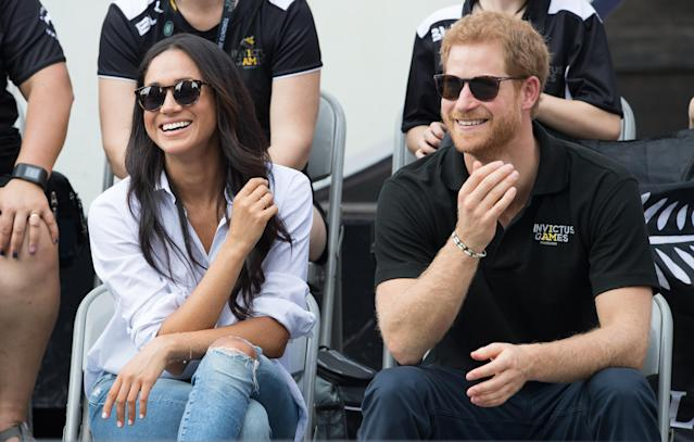 <p>The wait was over. Prince Harry and Markle finally made their first appearance together at the Invictus Games in Toronto. Aptly wearing a shirt called 'The Husband,' the actress was pictured smiling and laughing next to her royal partner. (Photo: Getty Images) </p>