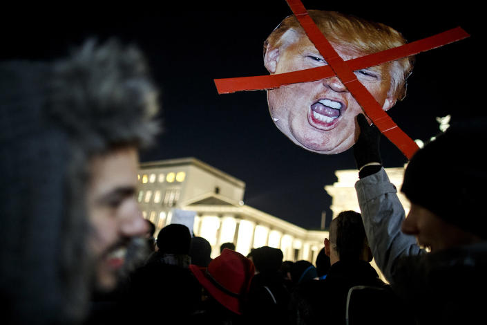 <p>Protesters critical of the recent election of Donald Trump as US President gather for a demonstration near the Brandenburg Gate on November 12, 2016 in Berlin, Germany. (Carsten Koall/Getty Images) </p>