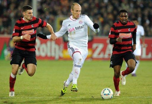 Bayern Munich's Arjen Robben (C) and Freiburg's Karim Guede (R) and Daniel Caligiuri (L) during their German league match on February 18. Bayern came off second best to a spirited Freiburg team who are threatened with relegation