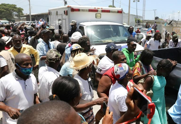 Supporters cheered the return to Haiti of the troubled nation's former president Jean-Bertrand Aristide, who spent nearly a month in Cuba for medical treatment and arrived back in Port-au-Prince following the assassination of president Jovenel Moise