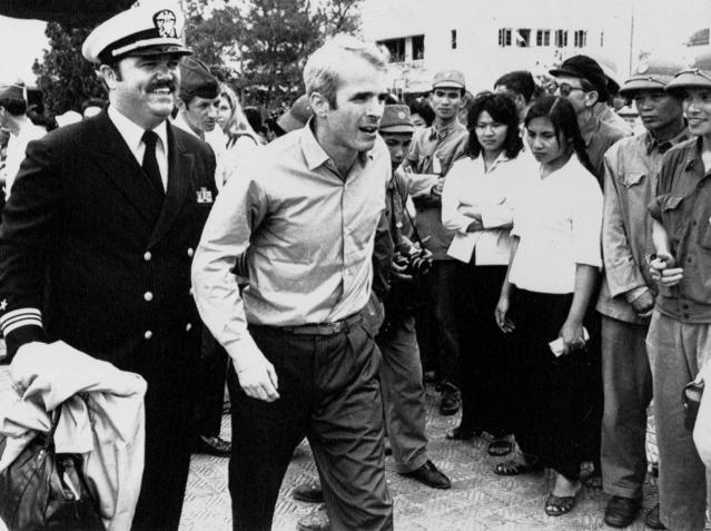 <p>McCain after his release in 1973, escorted by Lt. Cmdr. Jay Coupe Jr. (Photo: Horst Faas/AP) </p>