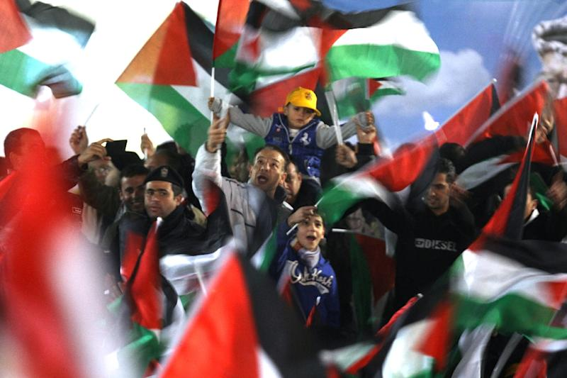 Palestinians celebrate in the West Bank city of Ramallah on November 29, 2012 after the General Assembly voted to recognise Palestine as a non-member state (AFP Photo/Abbas Momani)