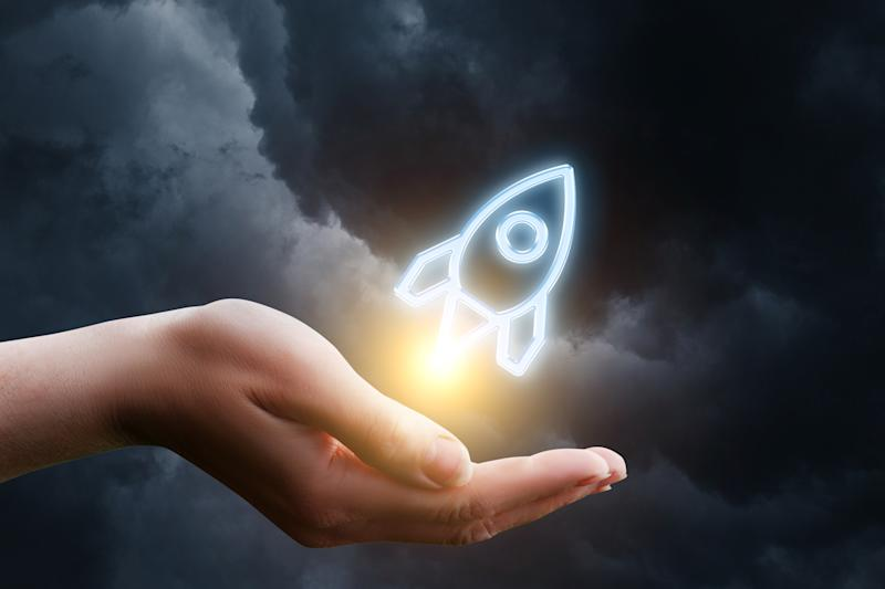 Drawing of a rocket taking flight from a person's cupped hand, set against a stormy background.