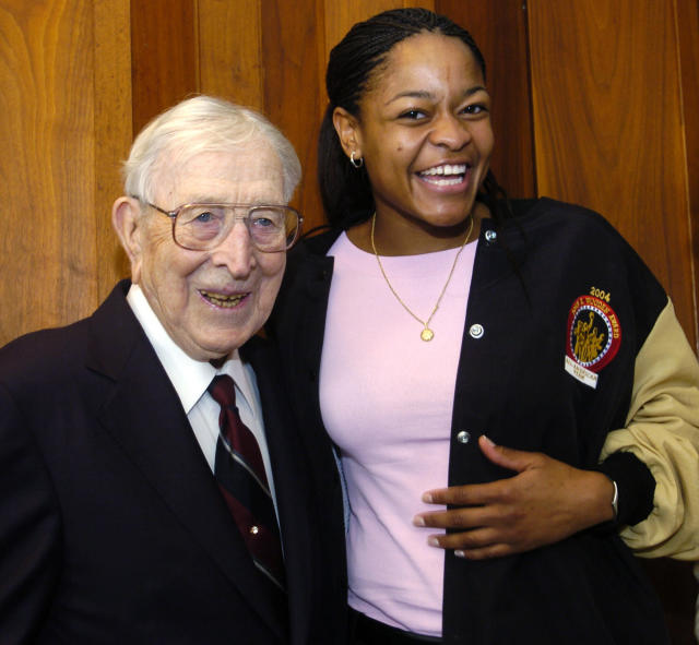 FILE - In this April 9, 2004, file photo, legendary basketball coach John Wooden poses with Duke basketball player Alana Beard after she won the inaugural Women's Wooden Award, given to the nation's best woman basketball player, in Marina del Rey, Calif. Alana Beard, a two-time Defensive Player of the Year who won a WNBA championship with the Los Angeles Sparks, is retiring after 15 years. The Sparks announced her decision on Thursday, Jan. 23, 2020. (AP Photo/Chris Pizzello, File)