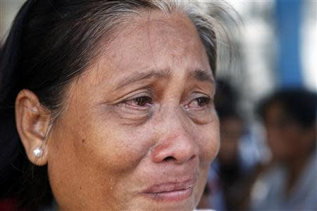 A woman weeps outside a police camp after failing to see her children amongst the hostages released by the Muslim rebels of Moro National Liberation Front (MNLF) in Zamboanga city in southern Philippines September 17, 2013. REUTERS/Erik De Castro