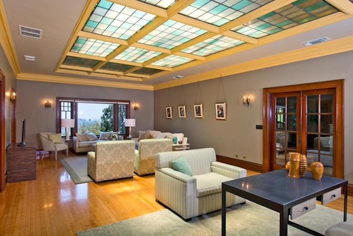 <p>The master suites include additional features like this spacious sitting room – with a leaded glass skylight.</p>