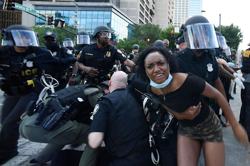 Police detain demonstrators protesting in Atlanta on Saturday. The protest started peacefully earlier in the day before demonstrators clashed with police. (Photo: ASSOCIATED PRESS)