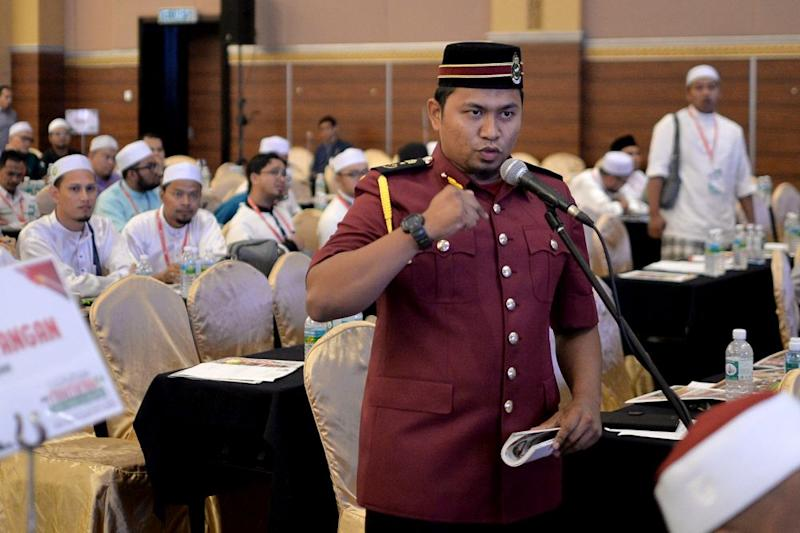 PAS Youth delegate Amirul Jufry speaks during Muktamar 2019 in Gambang, Pahang June 19, 2019. — Picture by Mukhriz Hazim