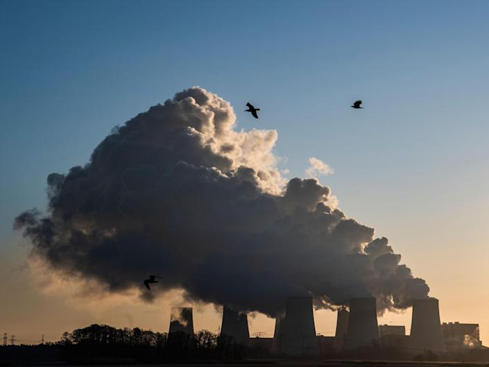 Smoke and vapor rising from the cooling towers and chimneys of the lignite-fired Jaenschwalde Power Station, eastern Germany: AFP via Getty Images