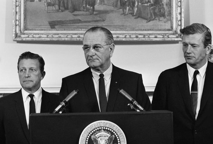 President Lyndon Johnson speaks to members of his advisory commission on civil disorders at the group's first meeting on July 29, 1967 at the White House, Washington. Otto Kerner, left, of Illinois, the chairman of the group and Mayor John Lindsay of New York (right) vice chairman. (AP)