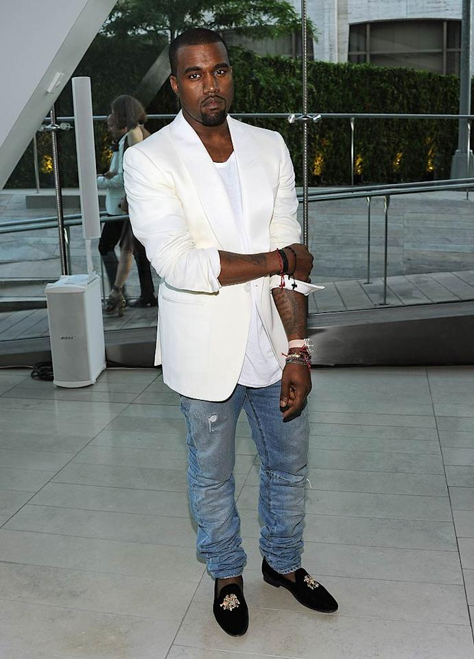 "A serious Kanye West rocked a white blazer along with jeans, despite the fact it was a pretty fancy soiree. Larry Busacca/<a href=""http://www.gettyimages.com/"" target=""new"">GettyImages.com</a> - June 6, 2011"