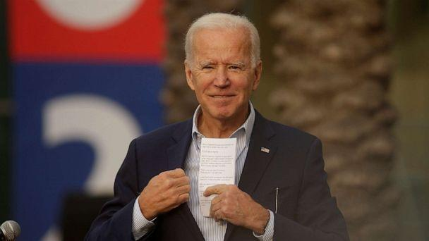 PHOTO: Democratic presidential candidate former Vice President Joe Biden saves his speech notes at the end of a campaign rally at Los Angeles Trade Technical College in Los Angeles, Nov. 14, 2019. (Damian Dovarganes/AP)