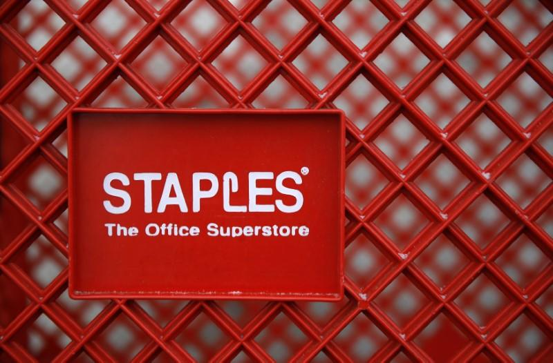 FILE PHOTO - A shopping cart is seen outside a Staples office supplies store in the Chicago suburb of Glenview, Illinois