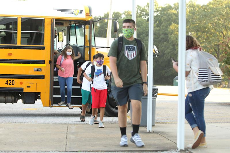 Students wearing masks head to class at Mooreville High School in Mooreville, Mississippi, on Thursday. The high school is not part of the Corinth School District, where seven coronavirus cases were confirmed. (Photo: ASSOCIATED PRESS)