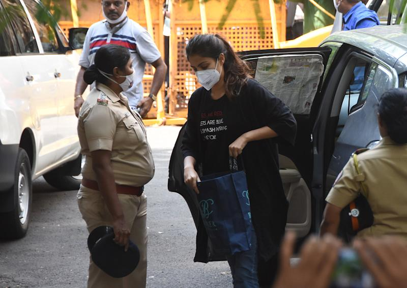 MUMBAI, INDIA - SEPTEMBER 8: Rhea Chakraborty outside NCB office after being summoned for questioning in connection with Sushant Singh Rajput's death case at Ballard Estate on September 8, 2020 in Mumbai, India. Actor Rhea Chakraborty was arrested on Tuesday after being questioned for five hours by the Narcotics Control Bureau on Monday. She is the 10th person to be arrested by the central agency in a drugs case linked to the probe into the death of Sushant Singh Rajput.(Photo by Bhushan Koyande/Hindustan Times via Getty Images)
