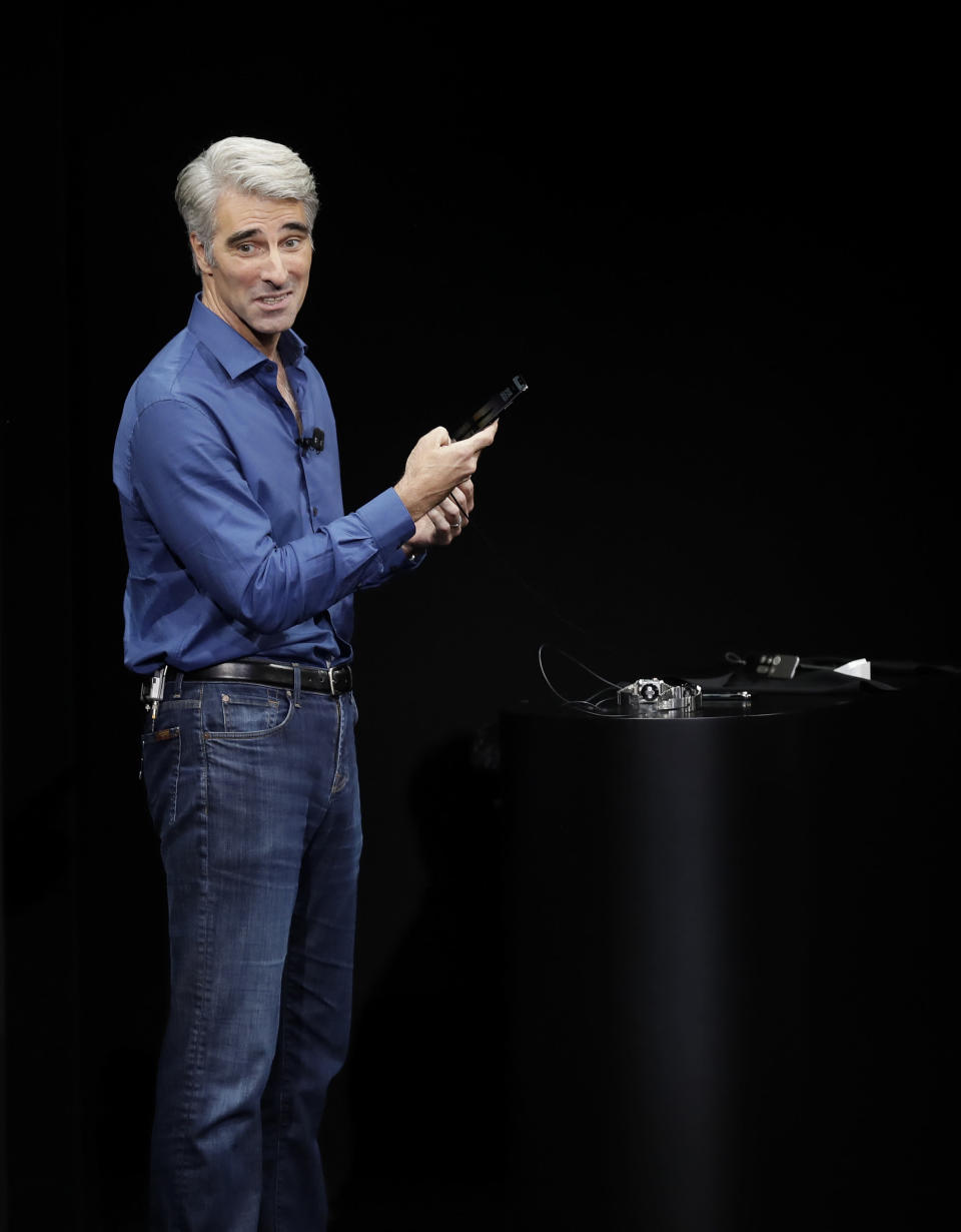 Craig Federighi, Apple's senior vice president of software engineering, discusses features of the new iPhone X at the Steve Jobs Theater on the new Apple campus on Tuesday, Sept. 12, 2017, in Cupertino, Calif. (AP Photo/Marcio Jose Sanchez)