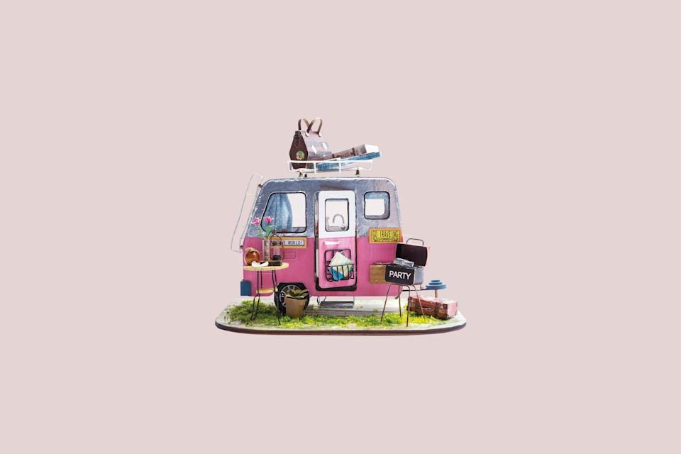 "<p>Consider this tiny camper set the Rolls Royce of miniature kits. Along with a pink trailer decked out with a kitchen, cookware, rug, and sink, this over-the-top mini camper kit comes with a barbecue grill, bistro table, and luggage so you can recreate a true vacation-inspired scene.</p> <p><strong><em>Shop Now: </em></strong><em>HandsCraftUS </em><em>DGM04, DIY Miniature Camper Van Kit: Happy Camper</em><em>, $35, <a href=""https://www.awin1.com/cread.php?awinmid=6220&awinaffid=272513&clickref=MSLTheMiniaturesTrendIsHavingaMomentTryOneofOurFavoriteKitssbamseyDIYGal7988105202009I&p=https%3A%2F%2Fwww.etsy.com%2Flisting%2F653076716%2Fdgm04-diy-miniature-camper-van-kit-happy"" rel=""nofollow noopener"" target=""_blank"" data-ylk=""slk:etsy.com"" class=""link rapid-noclick-resp"">etsy.com</a></em><em>.</em></p>"