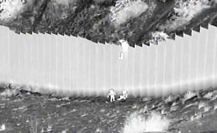 U.S. Border Patrol agents rescued two children who were dropped by smugglers from the border fence and abandoned Tuesday near Mount Cristo Rey, New Mexico.