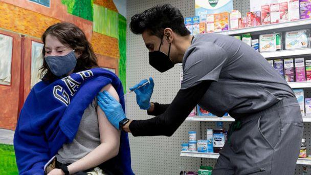 PHOTO: Julia Gadsby, 18, who has Lupus, receives the Pfizer-BioNTech vaccine against the coronavirus disease (COVID-19) at Skippack Pharmacy in Schwenksville, Pennsylvania, March 3, 2021. (Hannah Beier/Reuters, FILE)
