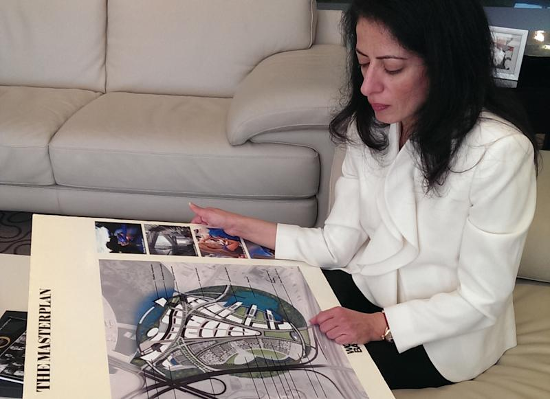 In this Jan. 30, 2014 photo, Amina Al-Rostamani, head of Tecom Investments, presents the Dubai Design District master plan in Dubai, United Arab Emirates. Dubai and luxury are nearly synonymous. The city is home to the world's tallest tower, massive manmade islands in the shape of palm trees and a fleet of police cars that include a Ferrari, Lamborghini and a $2.5 million Bugatti Veyron. To boost its glamour factor and economy, the city has its eyes set on the multi-billion dollar a year global fashion industry, which is currently dominated by the U.S., Europe and Japan. (AP Photo/Aya Batrawy)