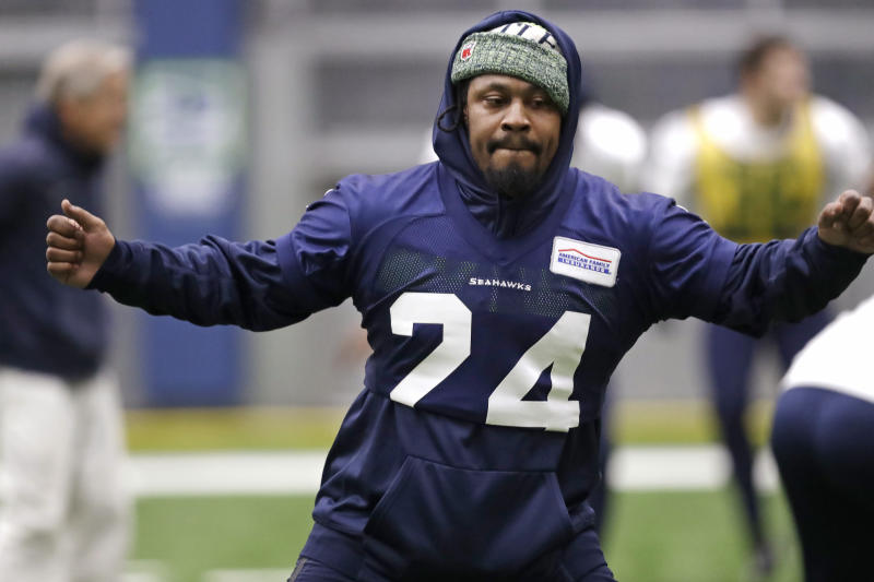 Seattle Seahawks running back Marshawn Lynch warms up at the NFL football team's practice facility Tuesday, Dec. 24, 2019, in Renton, Wash. When Lynch played his last game for the Seahawks in 2016, the idea of him ever wearing a Seahawks uniform again seemed preposterous. Yet, here are the Seahawks getting ready to have Lynch potentially play a major role Sunday against San Francisco with the NFC West title on the line. (AP Photo/Elaine Thompson)