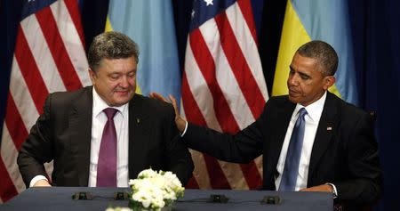 U.S. President Barack Obama meets with Ukraine President-elect Petro Poroshenko in Warsaw June 4, 2014. Obama promised on Tuesday to beef up military support for eastern European members of the NATO alliance who fear they could be next in the firing line after the Kremlin's intervention in Ukraine.  REUTERS/Kevin Lamarque (POLAND - Tags: POLITICS) - RTR3S44K