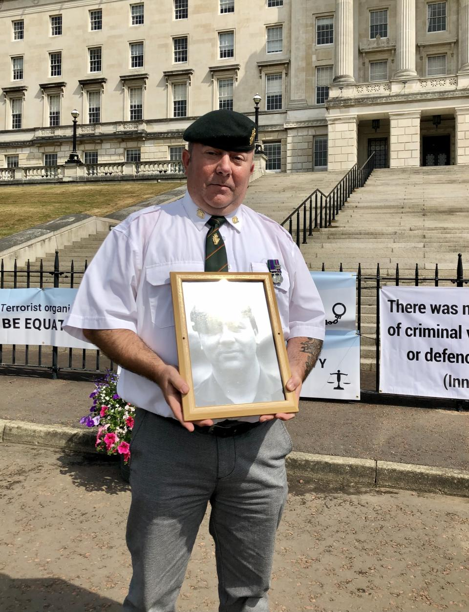 UDR veteran David Newell hold a picture of his murdered cousin lance corporal Kenneth Newell (David Young/PA)
