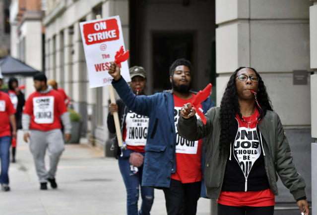 Workers from Unite Here Local 24 demonstrate at the Westin Book Cadillac in Detroit on Sunday. (AP)
