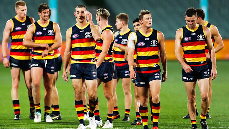 The Adelaide Crows are pictured walking off the field after their loss to St Kilda.