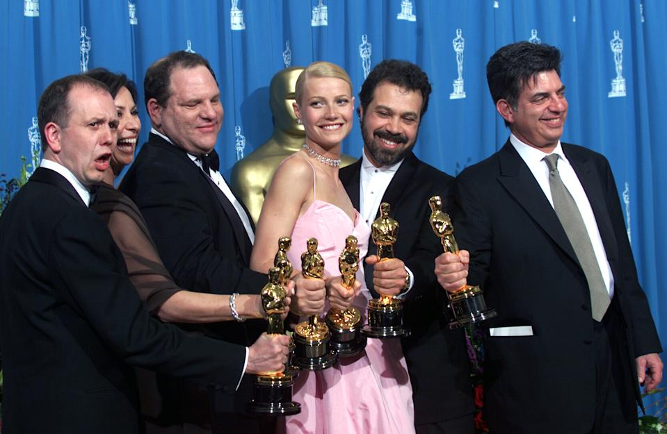 Shakespeare in Love'Best Actress winner Gwyneth Paltrow (centre) is joined by Harvey Weinstein (centre left) David Parfitt (left), Donna Gigliotti, Edward Zwick and Marc Norman (right) backstage as they celebrated their win of Best Picture at the 1999 Academy Awards..(Photo by Bob Riha, Jr./Getty Images)
