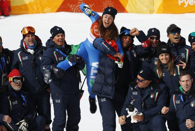 Alpine Skiing - Pyeongchang 2018 Winter Olympics - Women's Downhill - Jeongseon Alpine Centre - Pyeongchang, South Korea - February 21, 2018 - Gold medallist Sofia Goggia of Italy celebrates with her coaches and team members. REUTERS/Leonhard Foeger