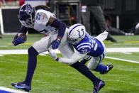 Tennessee Titans running back Derrick Henry (22) gets past Indianapolis Colts free safety Julian Blackmon (32) for a touchdown in the first half of an NFL football game in Indianapolis, Sunday, Nov. 29, 2020. (AP Photo/AJ Mast)