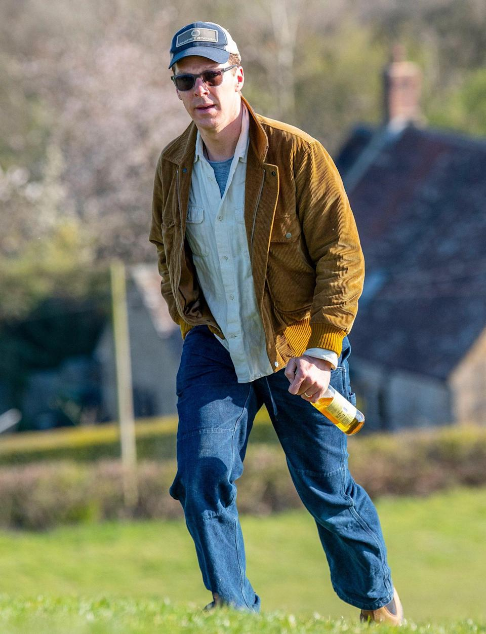 <p>Benedict Cumberbatch enjoys a bottle of cider on Burrow Hill in Somerset after the final day of filming <em>Doctor Strange</em> on Saturday.</p>