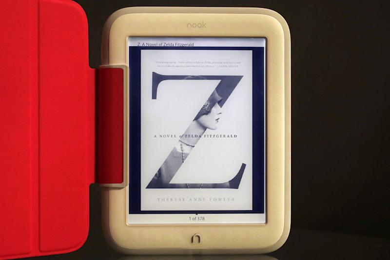 In this Monday, Oct. 28, 2013 photo, Barnes & Noble's new e-reader, Nook GlowLight, is demonstrated in New York. Barnes & Noble Inc. is releasing a new Nook e-book reader for the holidays, while it evaluates the future of tablet computers. The red cover is an optional accessory. (AP Photo/Mark Lennihan)