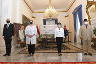 In this photo released by the Indonesian Ministry of Foreign Affairs, Australian Foreign Minister Marise Payne, second left, and Defense Minister Peter Dutton, left, pose for a photograph with their Indonesian counterpart Retno Marsudi, second right, and Prabowo Subianto, right, during their meeting in Jakarta, Indonesia, Thursday, Sept. 9, 2021. Australia's foreign and defense ministers are visiting Indonesia, India, South Korea and the United States to bolster economic and security relationships within the Asia-Pacific region, where tensions are rising with China. (Indonesian Ministry of Foreign Affairs via AP)