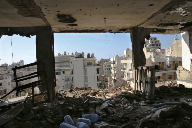 In this Nov. 17, 2018, photo, Shiyah, a Muslim Shiite neighborhood from a destroyed apartment in the southern Beirut Christian district of Ain el-Rummaneh, Lebanon. The two sides fought fierce battles during the 1975-90 civil war, which started with a shooting on a bus in Ain el-Rummaneh. (AP Photo/Hassan Ammar)