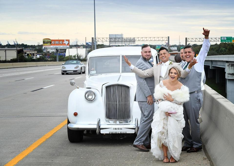 When the bride and groom's vintage ride broke down on the freeway, the couple didn't let it rain on their wedding day parade. (Photo: Courtesy of Tomas Romas)