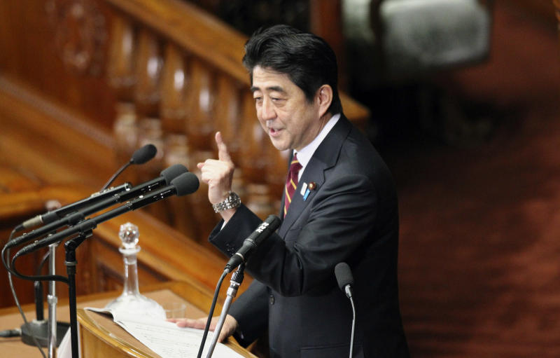 Japan's Prime Minister Shinzo Abe delivers his policy speech during a plenary session at the lower house of parliament in Tokyo, Thursday, Feb. 28, 2013. Abe vowed to push ahead with more aggressive monetary easing with the nomination Thursday of Asian Development Bank President Haruhiko Kuroda to head Japan's central bank.(AP Photo/Junji Kurokawa)